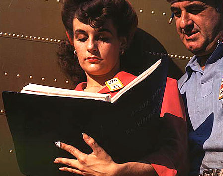 Woman consulting a book