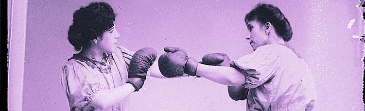 Early-twentieth-century photo of two women boxing